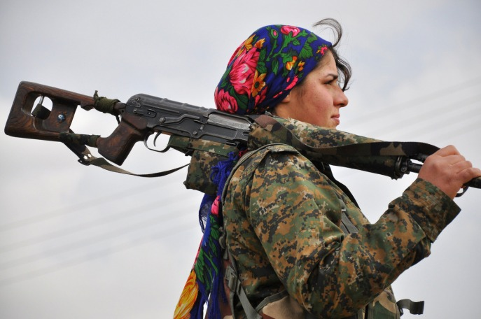 TOPSHOTS A Kurdish female fighter of the People's Protection Units (YPG) looks on at a training camp in al-Qahtaniyah, known to Kurds as al-Darbassiyah, near the Syrian-Turkish border on February 13, 2015. Syrian Kurdish forces have recaptured more than a third of the villages around Kobane from the Islamic State (IS) group since routing the jihadists from the town a fortnight ago, a monitor said last week. AFP PHOTO / DELIL SULEIMANDelil Suleiman/AFP/Getty Images